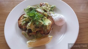 Avocado with Blood Orange, Marinated Goat's Cheese, Basil, Almonds and Radish on Toast with a Poached Egg