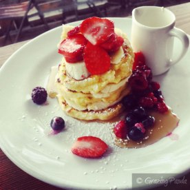 Ricotta Pancakes with Banana, Berries, Maple Syrup and Cream